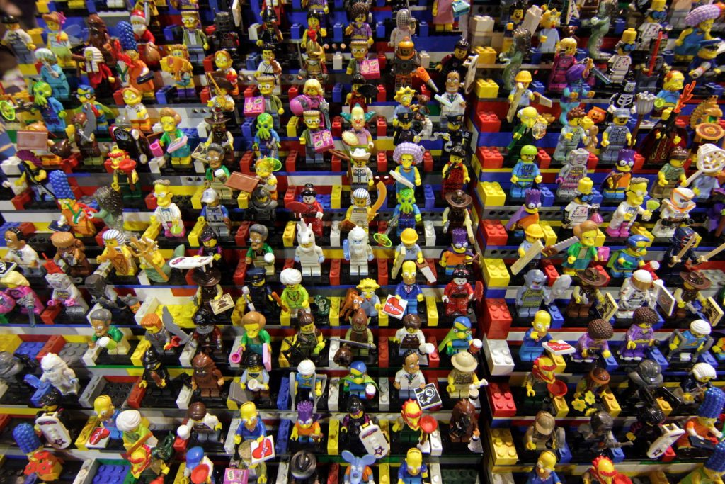A lot of Lego people sitting in Lego bleachers.